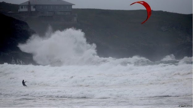 A kite surfer braved the waves crashing into Newquay, Cornwall.