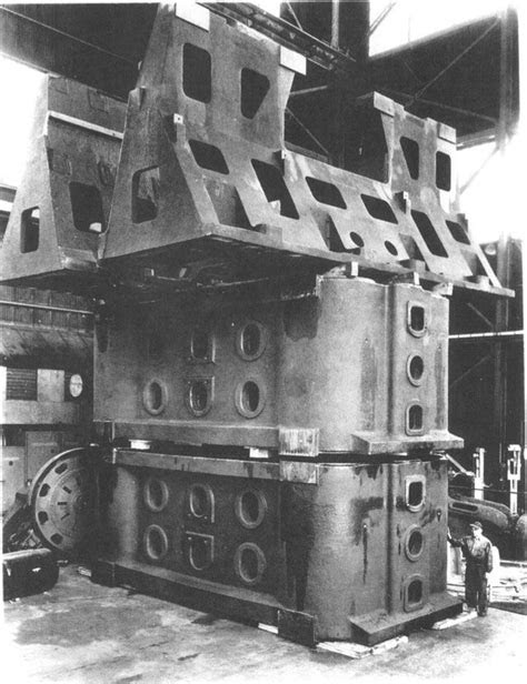"the ""Fifty"", a massive press forge that presses foot-thick"