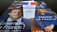 A picture taken on May 4, 2017 shows a voter ID displayed on top of campaign flyers of French presidential candidates Emmanuel Macron and Marine Le Pen in Nantes on May 4, 2017 ahead of the second round of the presidential election on May 7. / AFP PHOTO / LOIC VENANCE        (Photo credit should read LOIC VENANCE/AFP/Getty Images)