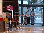 Tragic: Forensic officers attends the scene at Westfield in Stratford, east London, after a man was stabbed to death