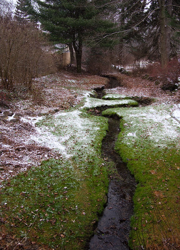 stream meandering, snow on grass