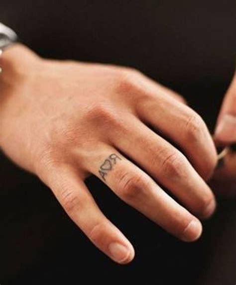 faint wedding ring tattoo  husband's initials   Love love