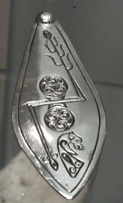 Silver plaque from the Norrie's Law hoard (7th-century Pictish silver hoard), Fife, with double disc and Z-rod symbol