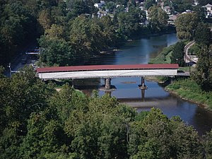 The Philippi Covered Bridge (1852) spans the T...