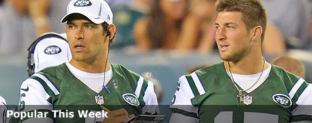 Mark Sanchez (left) and Tim Tebow in preseason action; Sanchez has been spotted with Eva Longoria. (Getty Images)
