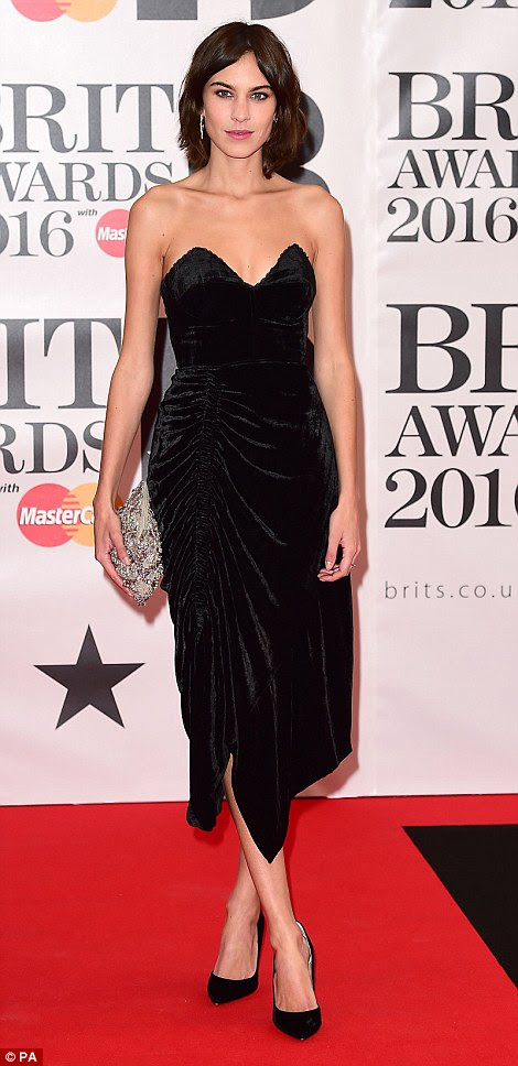 Lovely, lovely look:Fashionista, writer and all-round good girl Alexa Chung proved she never puts a fashion footstep wrong in her elegant velvet mid-length dress with a sweetheart neckline
