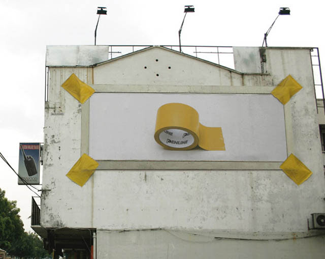 billboard showing off strength of tape using mock tape to hold up billboard