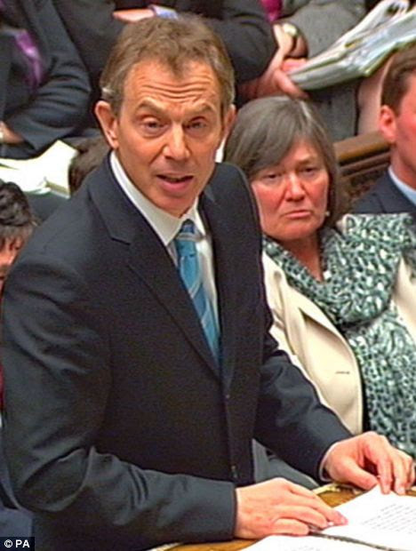 Tony Blair secures MPs' support for war on March 18, 2003, as Clare Short looks on