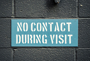 Prison sign that says No Contact During Visits