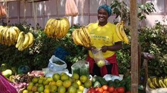 Woman selling bananas in Africa