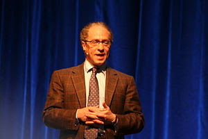 Picture of Ray Kurzweil giving a speech.