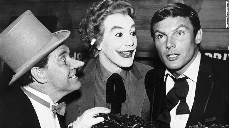 "Burgess Meredith as the Penguin, Cesar Romero as the Joker, and Adam West as Bruce Wayne appear in the 1960s ""Batman"" TV show."