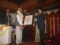 SRI R BASUMATARY, DIRECTOR, BATHOU MISSION, BTAD, ASSAM  RECEIVING THE VKIC SANMAAN 2012 FROM SRI SOM KAMEI, DIRECTOR, NEZCC, DIMAPUR