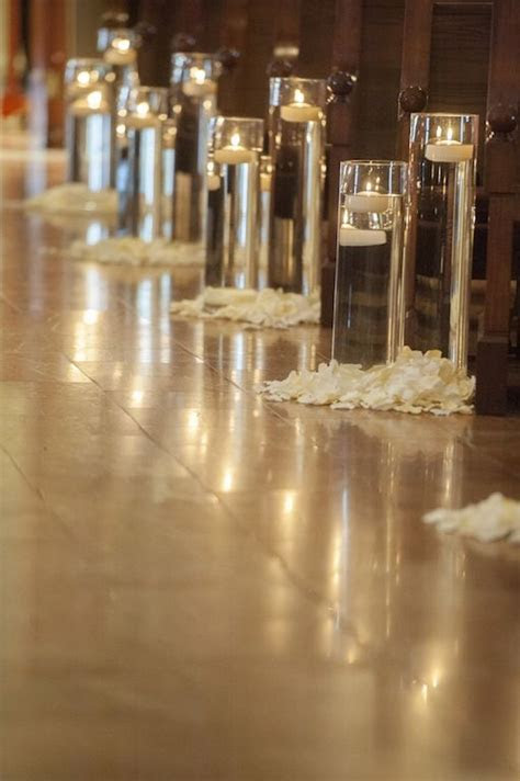 floating candles in glasses and petals, aisle and ceremony