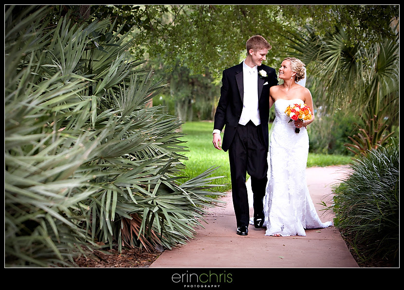 Bride and Groom wedding photo walking in front the Mahaffey Theater in St. Petersburg, Florida.
