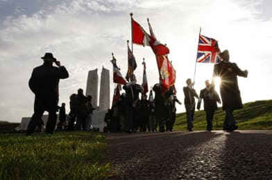 A colours guard marches away from the Canadian National Vimy  Memorial in France in November 2008. (Reuters)