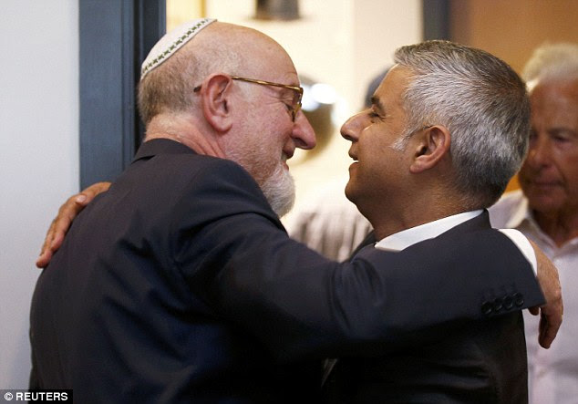Sadiq Khan used his first act as Mayor of London to attend the UK's Holocaust Memorial Ceremony in Barnet today - 24 hours after the last Labour mayor repeated controversial claims that Hitler was a Zionist