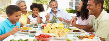 Photo: Family eating outdoors