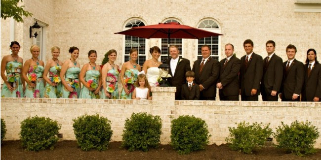 The wedding party liens the entire area of this church patio