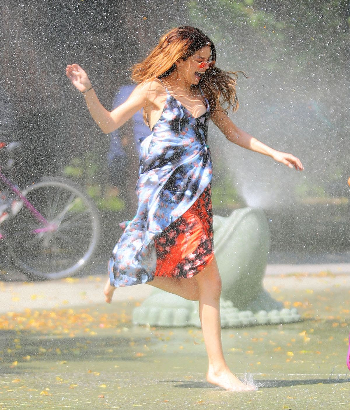 SELENA GOMEZ Running Thru Sprinklers at Water Playground in Brooklyn 06/01/2016