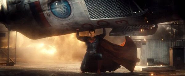 The Man of Steel carries a Russian rocket capsule to safety following a launch mishap in this scene from the BATMAN V SUPERMAN: DAWN OF JUSTICE Comic-Con trailer.