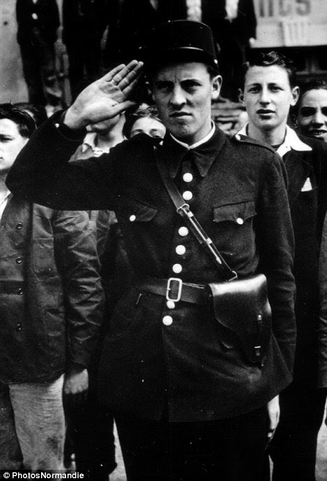 A policeman salutes in Cherbourg