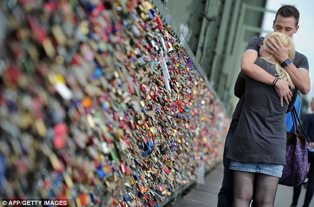 Bridge of Love: Thousands of padlocks have been hung on bridges by romantic couples throughout Europe after the craze began on Rome's Tiber bridge
