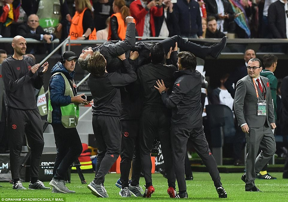 Jose Mourinho, the Old Trafford manager, is held aloft by his coaching staff following the full-time whistle at Friends Arena