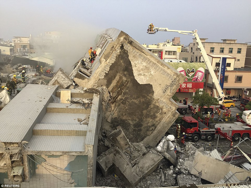 Rescue personnel work on damaged buildings after an earthquake in Tainan, southern Taiwan