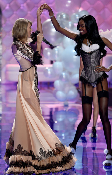Taylor Swift Takes Maria Borges' Hand