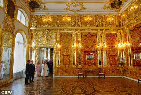 Foreign dignitaries admire the Amber Room after a complete restoration in the Catherine Palace in St. Petersburg, Russia, in 2003. A Russian treasure hunter claims he has found the original Amber Room in Kaliningrad