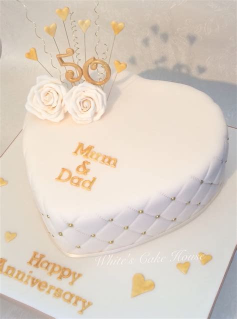 Heart shaped golden anniversary cake    Weddings in 2018