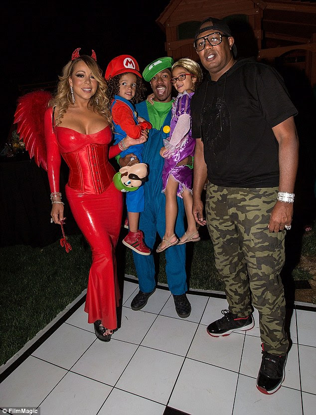 Adorable: Nick proved her was as involved in the theme of the day as his ex spouse as he dressed up as Mario from the beloved computer game Super Mario