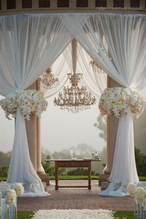 Drapery with outdoor ceremony pillars   simple wedding