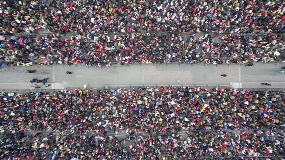 Multitudes en la estación de tren de Guangzhou. Foto: Reuters.
