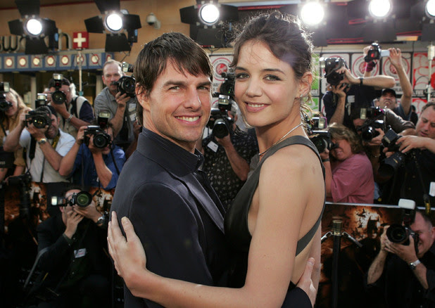 At the early stages of their relationship, the happy couple attending Batman Begins film premiere in June 2005