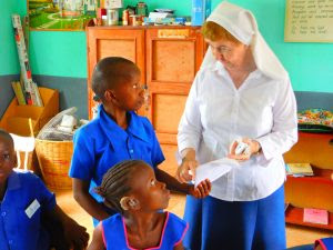 Sr Mary Sweeney with some children at St Joseph's school.