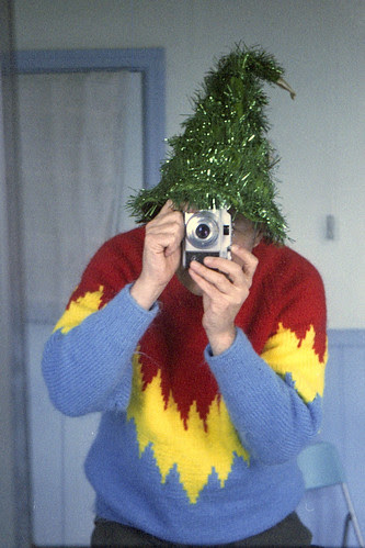 reflected self-portrait with Agfa Sillette camera and xmas tree hat by pho-Tony