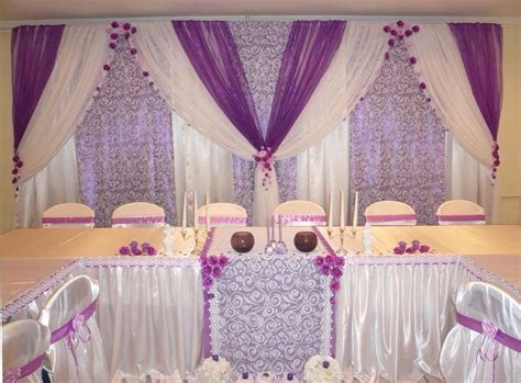 Purple voile over lavender patterned and white drapes