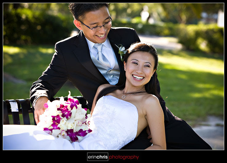 Wedding photo of bride and groom on a bench