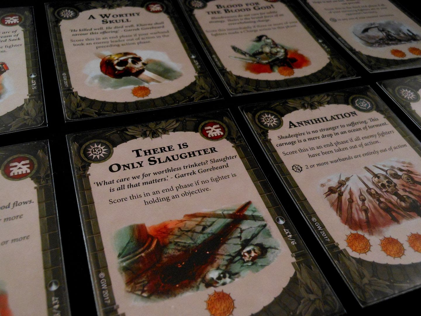 A selection of objective cards from Warhammer Underworlds: Shadespire.