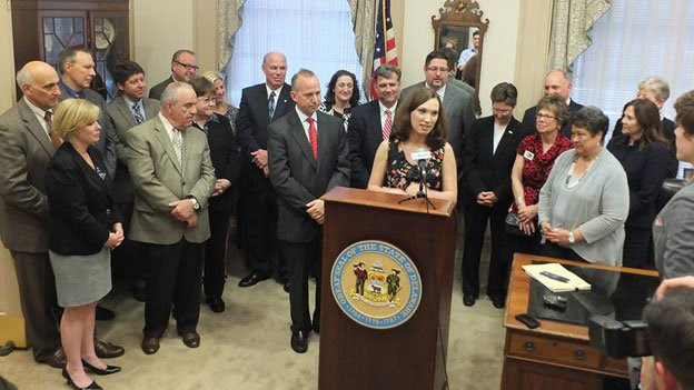 Sarah McBride speaks at the signing of Delaware's Gender Identity Nondiscrimination Act, which she helped pass.