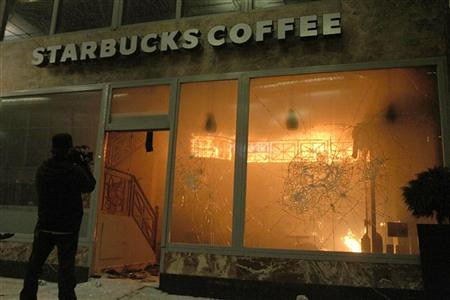 Starbucks engulfed in flames after Greek workers and youth went out in rebellion opposing another round of austerity measures imposed by international finance capital. Parliament acquiesced to the imposition of draconian cuts. by Pan-African News Wire File Photos