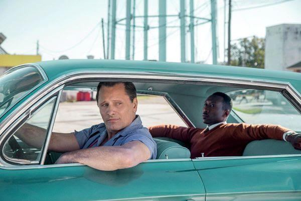 Viggo Mortensen as Tony Lip, and Mahershala Ali as Don Shirley in GREEN BOOK.