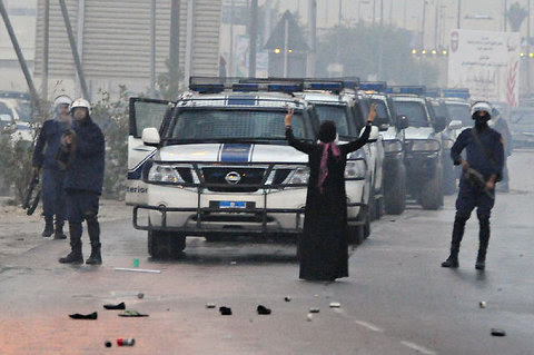 As the security forces in Bahrain fired tear gas at protesters on Saturday, Zainab Alkhawaja, an activist and blogger, blocked a line of police vehicles.