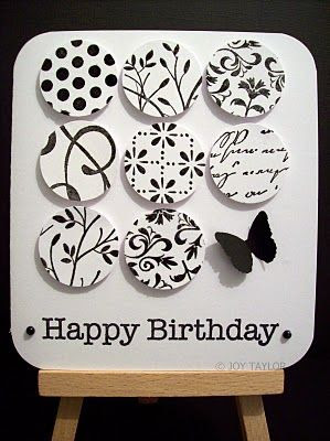 luv this black and white card with the nine patch done in circles, each one stamped with a different image...