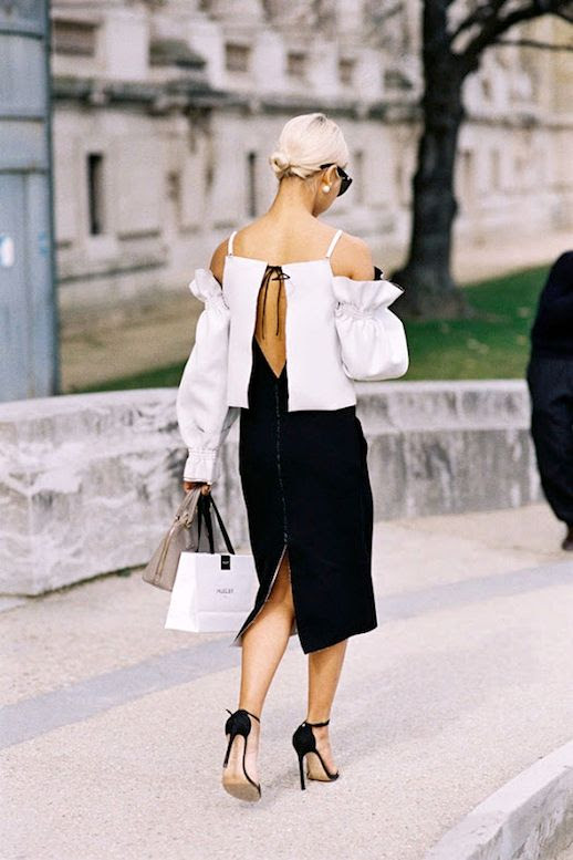 Le Fashion Blog Blogger Style Low Bun Sunglasses Pearl Earrings Black And White Deconstructed Cold Shoulder Open Back Dress Strappy Heeled Sandals Via Vanessa Jackman