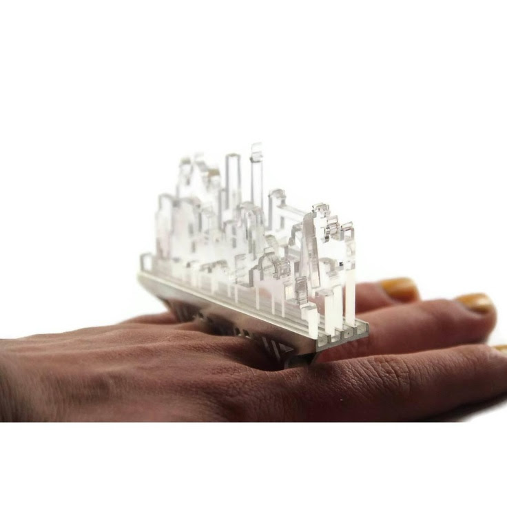 "Cityscapes Knuckle Duster Ring | Christina Elleni - 945€  ""This ring has laser cut perspex city silhouettes from countries I have travelled to"""