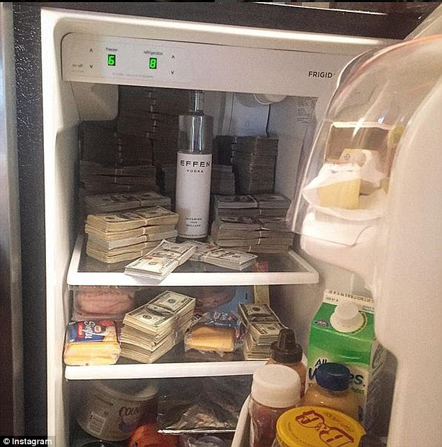 Cold, hard cash: Another pic showed a fridge stuffed with 'money.' The images were flagged by Lastonia Leviston, who won $7million in the sex-tape dispute but cannot collect because 50 Cent says he is broke
