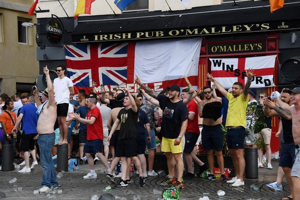 England fans gesture as they gather in Marseille, southern France